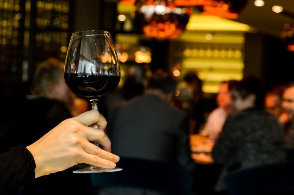 Proper holding a wine glass